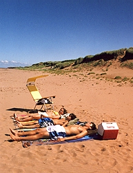 Dunes Beach House - sunbathing on beach